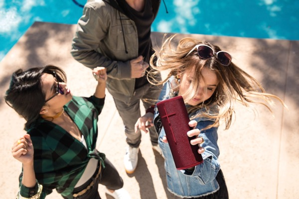 3 Young Adults Dancing With Girl Holding UE Boom 3 Speaker