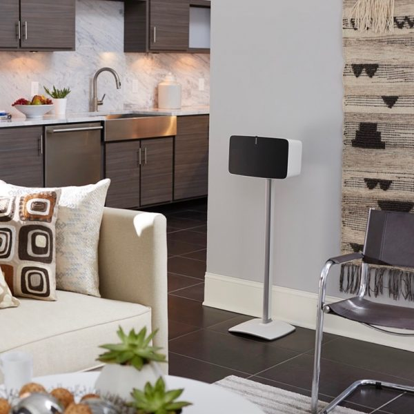 SANUS WSS51 Wireless Speaker Stand Designed For Sonos In White With Speaker Lifestyle Photograph In Living Room