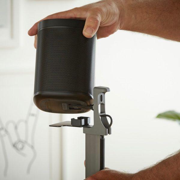 SANUS WSSA2 Adjustable Speaker Stands Designed For Sonos Attaching Speaker Lifestyle Photograph