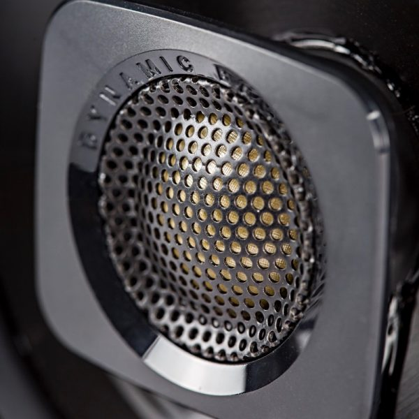 "Polk DB+ Series 4"" Coaxial Speaker Black Side Angle With Grille On Black Background"