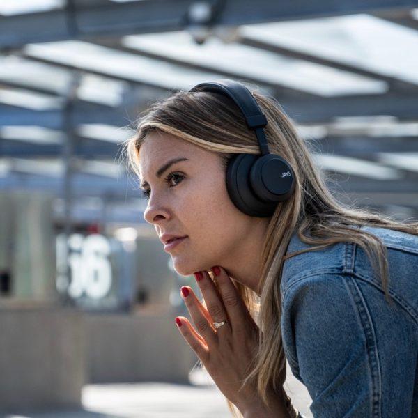 JAYS q-Seven Wireless Headphones In Black Outside Lifestyle Photograph Women Wearing Headphones