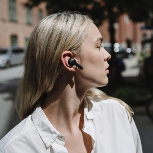 JAYS f- Five True Wireless Earphones Lifestyle Worn By Woman Photograph