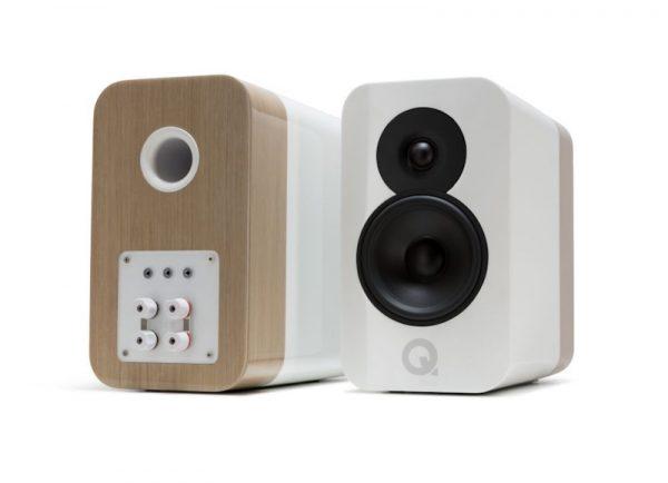 Q Acoustics Concept 300 Stereo Bookshelf Speakers In Gloss White And Light Oak On White Background